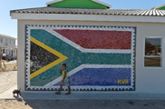 Manenberg and Gugulethu youth adorn new housing units with mosaics